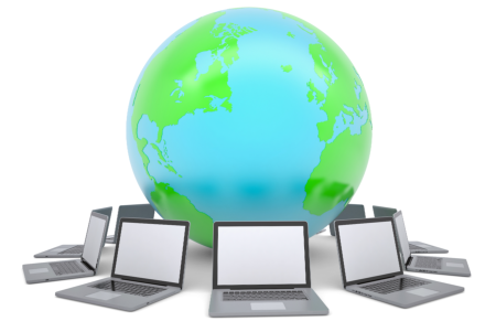 Globe surrounded by laptops